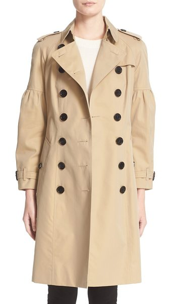 Burberry redhill puff sleeve cotton trench in beige - Puffed sleeves soften the military styling of a...