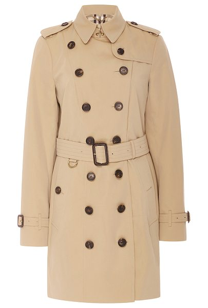 Burberry Sandringham Double Breasted Trench Coat in tan - A perennial classic this season the *Burberry* signature...
