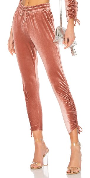 by the way. Behati Ruched Velour Jogger in pink - 95% poly 5% spandex. Hand wash cold. Elasticized...