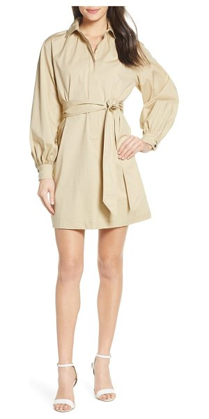 CAARA orzo belted long sleeve cotton shirtdress in beige - Crisp cotton plays to and against type on this...