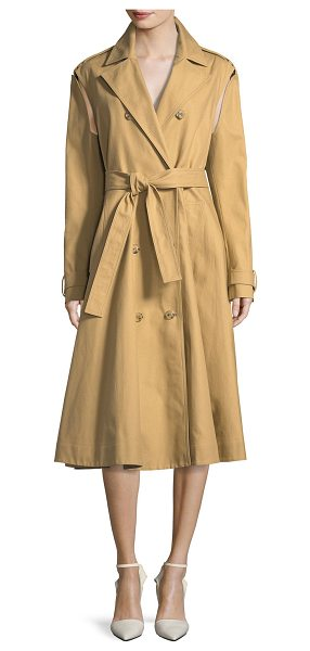 CALVIN KLEIN 205W39NYC Double-Breasted Swing Trench Coat with Detachable Sleeves in sand - CALVIN KLEIN 205W39NYC cotton trench coat. Notched...