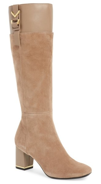 Calvin Klein candace knee high boot in brown - A flashy buckle detail at the topline provides a refined...