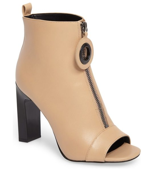 Calvin Klein minda open toe bootie in sandstrom leather - A striking setback heel elevates a contemporary open-toe...