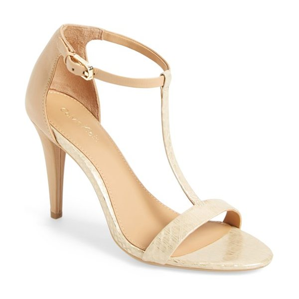 Calvin Klein nasi leather t-strap sandal in light gold/ sand gold - Sleek, minimalist design and modern color blocking in...