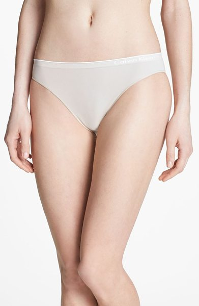 Calvin Klein seamless bikini in almond - The smoothly banded leg openings and logo waistband of a...