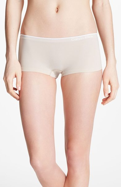 Calvin Klein seamless hipster briefs in almond - The smoothly banded leg openings and logo waistband of...