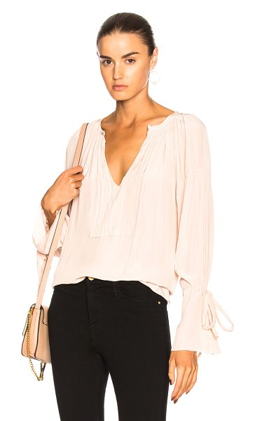 Calvin Rucker for FWRD Tenderness Top in pink - Calvin Rucker is the eponymous label from the...