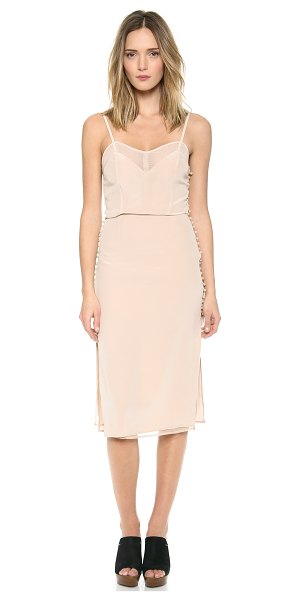 CARMELLA Jessamy dress in nude - Embroidered buttons close the split sides of this silk...