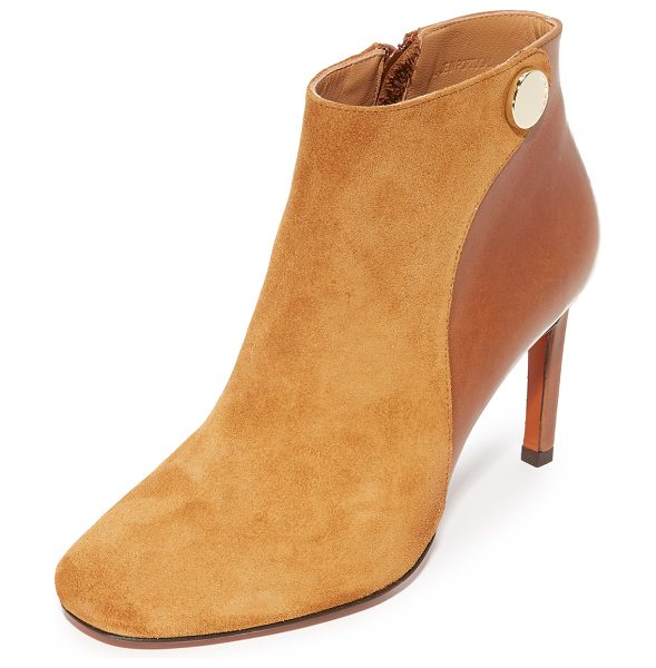 Carven Carven Booties in cognac - A polished stud accents the top line on these smooth...