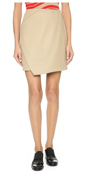 Carven Cross panel miniskirt in camel - A classic Carven skirt with an uneven panel in front....