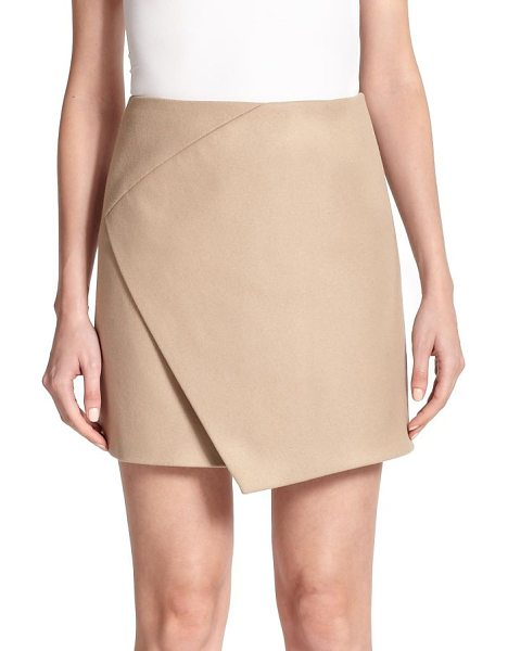 Carven Faux wrap skirt in camel - This chic skirt fits tailored through the hips, then...