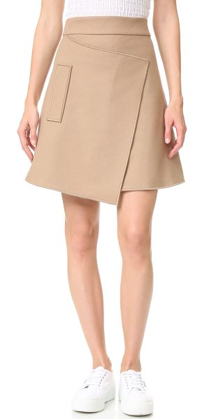 Carven felt skirt in camel - This asymmetrical Carven skirt is crafted with an angled...