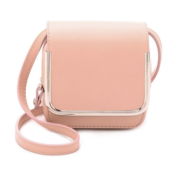 Carven Leather cross body bag in nude - A structured Carven bag in a compact, square silhouette....