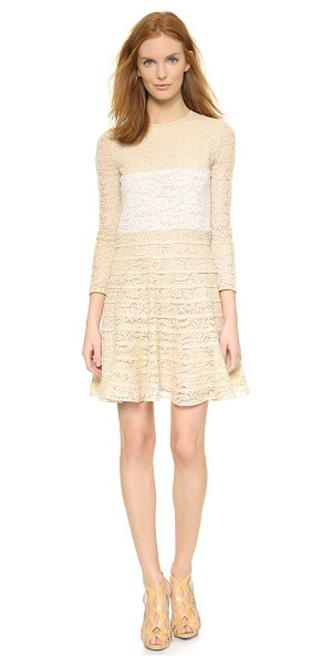 Carven Long sleeve lace dress in ecru - Contrast panels cut clean lines over the bodice and...