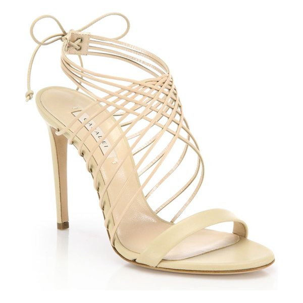 Casadei Leather crisscross sandals in nude - Elegantly upswept crisscross sandal in smooth...