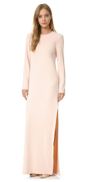 Cedric Charlier long sleeve gown in pink - A minimalist Cedric Charlier gown with high slits at the...
