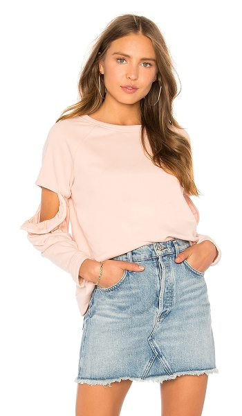 Central Park West Clover Cut Out Ruffle Sweatshirt in blush - 60% cotton 40% poly. Hand wash cold. Shoulder cut-out...