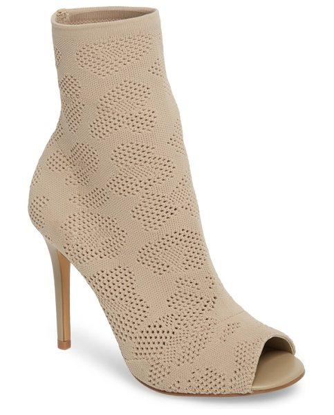 Charles by Charles David ranger sock knit open toe bootie in nude stretch fabric - A sock-knit bootie with a peekaboo toe opening is lifted...