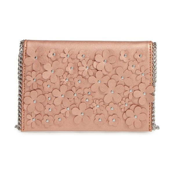 CHELSEA28 floral faux leather clutch in rose gold - Studded floral embellishments add eye-catching dimension...