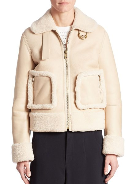 Chloe cropped shearling jacket in beige-white - Shearling trimmed jacket in zip-front style. Fold-over...