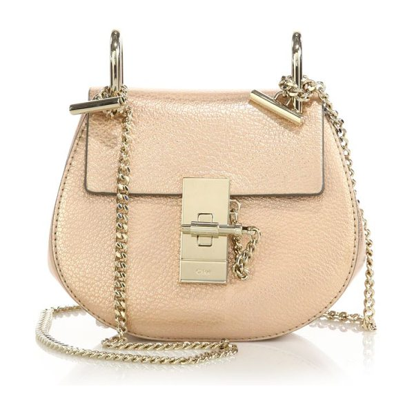 Chloe drew nano leather saddle crossbody bag in gold - A lustrous metallic finish and sleek, radiant hardware...