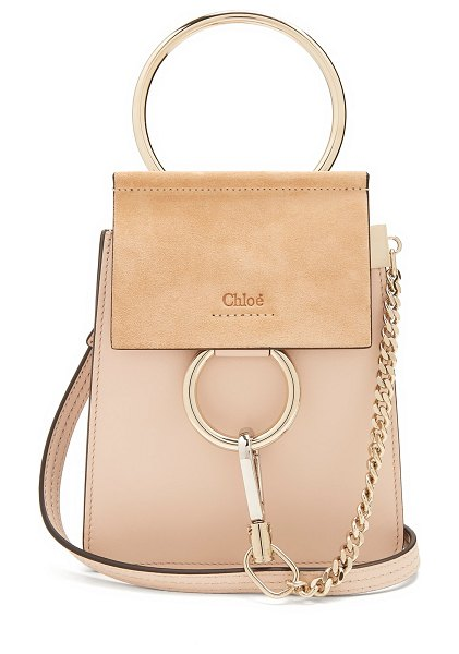 Chloe Faye mini suede-panel leather cross-body bag in light pink - Chloé reworks its coveted Faye bag into a smaller...