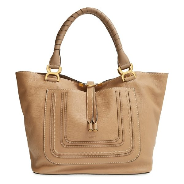 Chloe Marcie in nut - Subtle embossing embellishes the front pocket of a...
