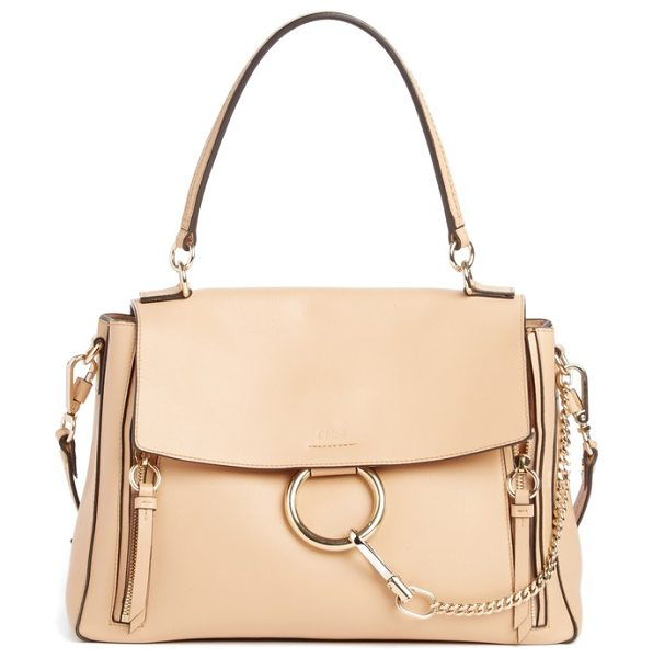 Chloe medium faye leather shoulder bag in pink - Iconic equestrian-inspired hardware gleams against the...