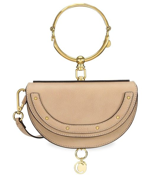 Chloe nile half moon leather minaudiere in biscottibeige - Studded half-moon silhouette with bracelet handle....