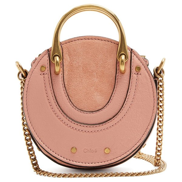 Chloe Pixie mini leather and suede cross-body bag in pink - Chloé scales down its Pixie bag to a mini size perfect...