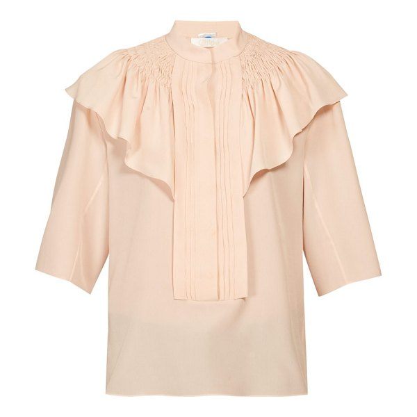 Chloe smocked and ruffle-shoulder crepe blouse in light pink
