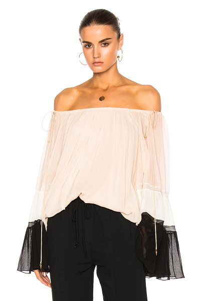 Chloe Textured Silk Crepon Off Shoulder Blouse in black,pink,white - Self: 100% silk - Lining: 100% poly.  Made in France. ...