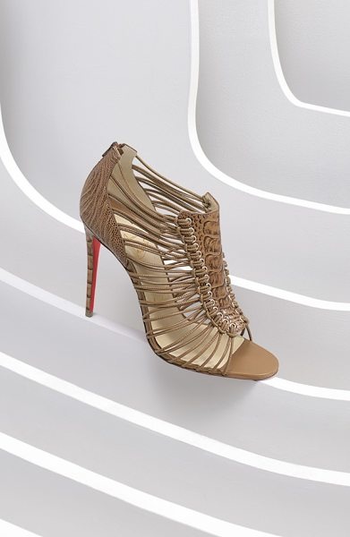 Christian Louboutin amal ostrich leather sandal in tan ostrich - Knotted cord straps secure the embossed shield detail on...