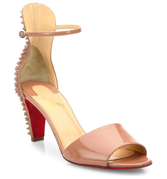 Christian Louboutin Mini stud patent leather ankle-strap sandals in nude - Edgy ankle-strap sandal backed by tonal spiked studs....