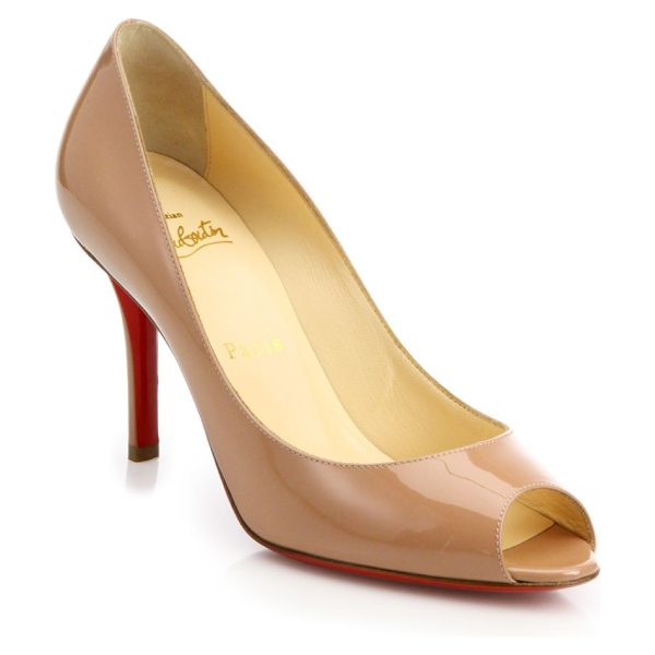 Christian Louboutin patent leather peep-toe d'orsay pumps in nude - Timeless patent d'Orsay pump finished with a peep toe....