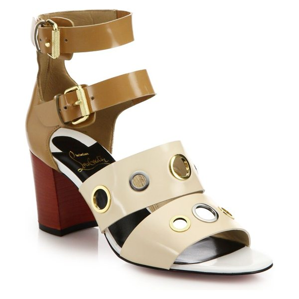 CHRISTIAN LOUBOUTIN Scuba grommet-studded leather sandals - Mixed-metal grommets lend a touch of city-chic attitude...