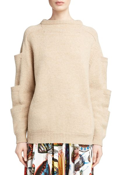CHRISTOPHER KANE sleeve pocket wool sweater in oatmeal - Stacked patch pockets ladder up the sleeves of a soft,...