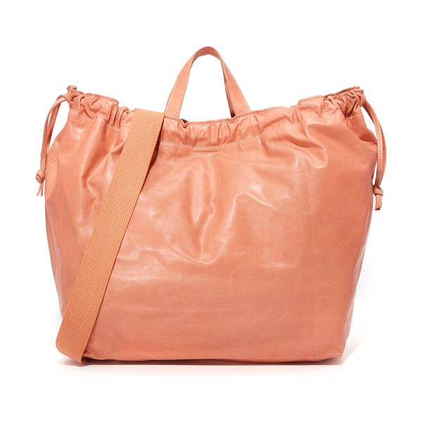 Clare V. drawstring tote in salmon - A knotted drawstring cinches the top of this slouchy...