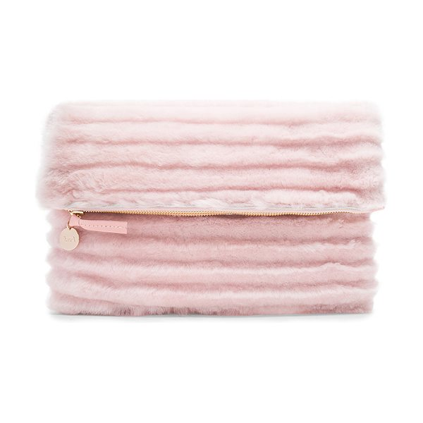 Clare V. Foldover Clutch in blush - Dyed shearling exterior with denim fabric lining. Zip...