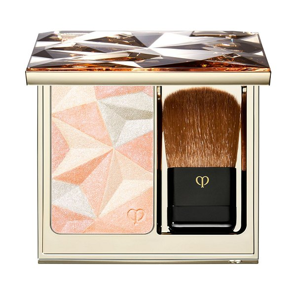 Clé de Peau Beauté luminizing face enhancer in pink - This exquisite highlighting powder uses innovative...