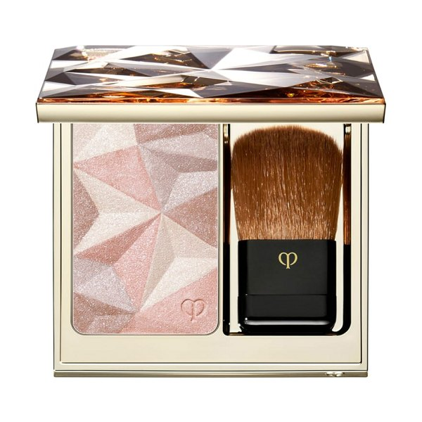 Cle de Peau Beaute luminizing face enhancer in almond - An exquisite highlighting powder that uses innovative...