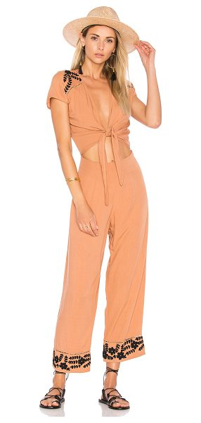 Cleobella Olivera Jumpsuit in terracotta - Rayon blend. Hand wash cold. Front cut-out with tie...