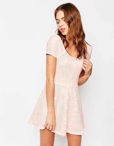 Club L Cross back skater dress in geo-tribal lace in pink - Casual dress by Club L Semi-sheer textured, perforated...