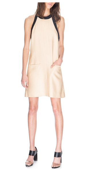 C/Meo Collective do it again halter minidress in sand - A clean center seam runs down the front of a...