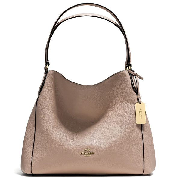 COACH Edie pebbled leather shoulder bag in stone - In a beautiful representation of form-meets-function,...