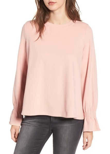CODEXMODE cinch cuff pullover in blush - Cinched at the cuffs to create playful volume, this...