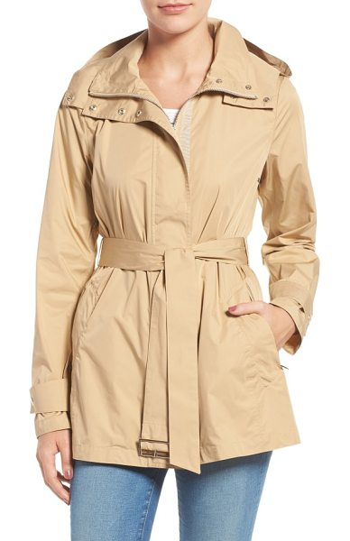 Cole Haan packable belted rain coat in barley - A lightweight jacket features a hood zipped into the...