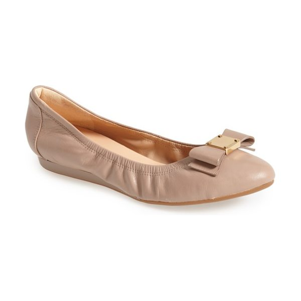 Cole Haan 'tali' bow ballet flat in beige - A sleek bow accented with logo-embossed goldtone...
