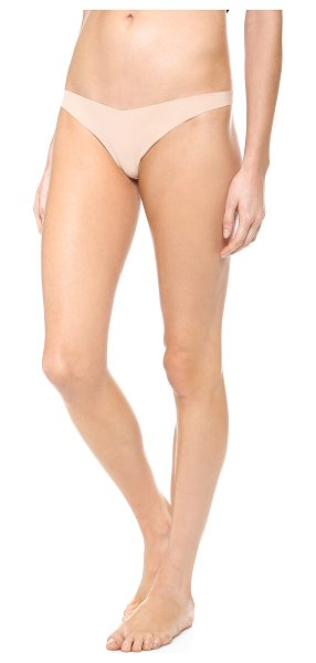 Commando classic tiny thong in true nude - Invisible under everything, this jersey thong features...