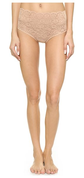 Commando High rise panties in true nude - Sheer lace composes the front of these high rise...